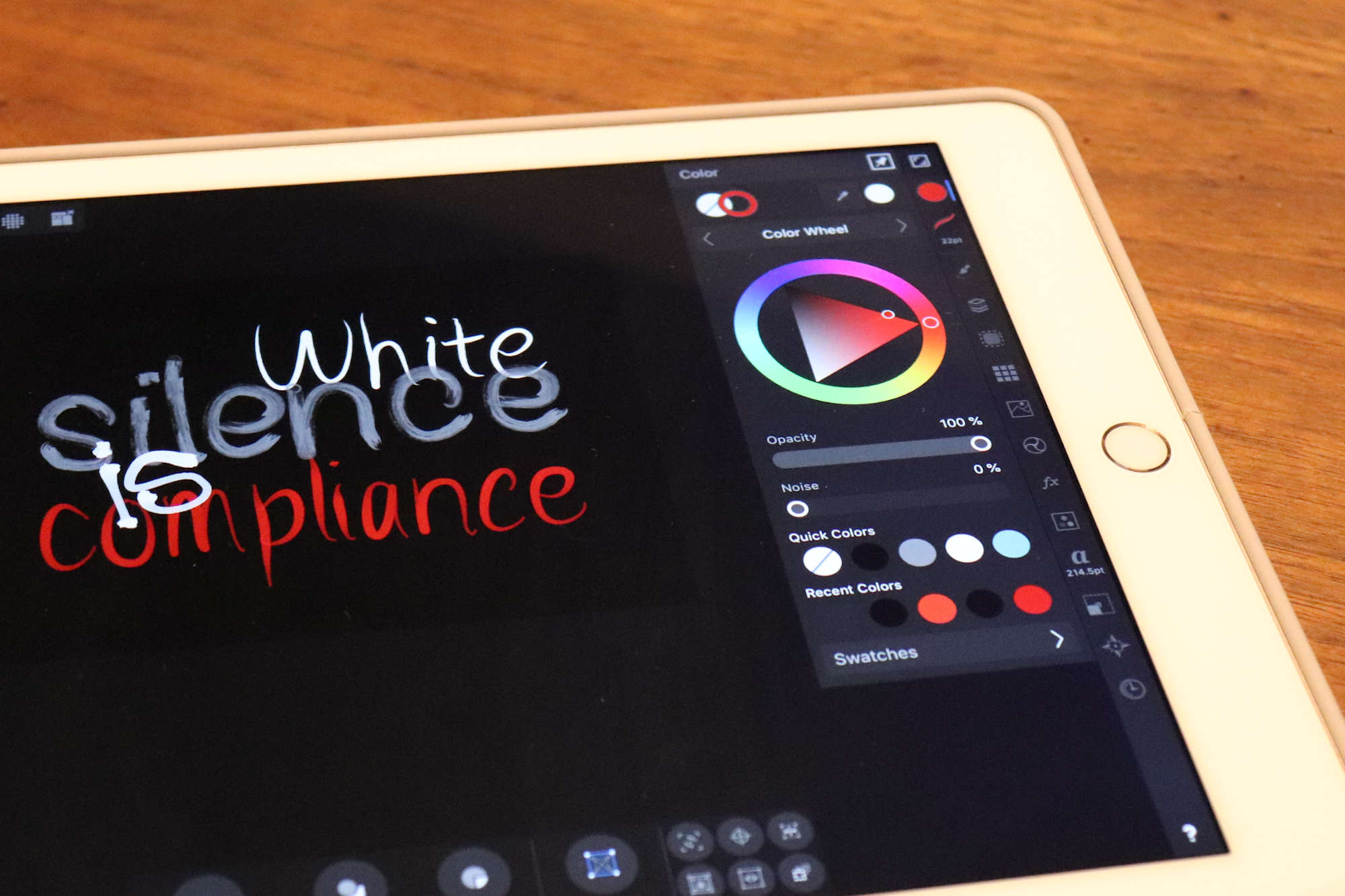"An iPad with a graphic reading ""white silence is compliance"""